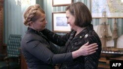 Like U.S. Assistant Secretary of State Victoria Nuland (right), former Ukrainian Prime Minister Yulia Tymoshenko (left) has been caught on tape using some rather forceful, undiplomatic language. (file photo)