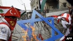 Several hundred protesters burned a Star of David near the U.S. Embassy in Lebanon today to call for an end to Israel's blockade of the Gaza Strip.