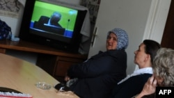 Muslim women in Sarajevo, survivors of the 1995 Srebrenica massacre, watch a live television broadcast in May of the first day of Ratko Mladic's trial in The Hague.