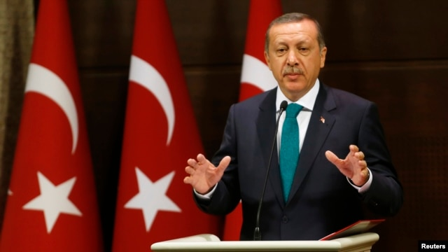 Turkish Prime Minister Recep Tayyip Erdogan addresses the media in Ankara on September 30.