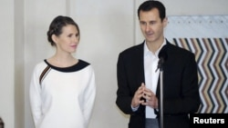 Syria's President Bashar al-Assad and his wife, Asma