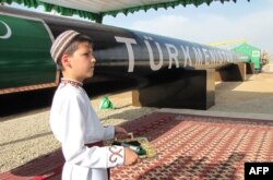 A Turkmen boy in traditional dress takes part in a gas pipeline ceremony. (file photo)