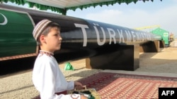 A Turkmen boy at an official launch ceremony for the East-West gas trunk pipeline in Shatlyk on May 31, 2010.