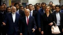 فدریکا موگرینی ،یوکیاآمانو و محمد جواد ظریف در وین، در روز به اجرا درآمدن توافق اتمی بین ایران و گروه ۵+۱