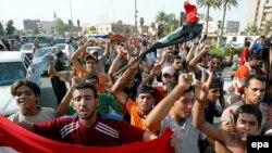 مردم بغداد در حال خوشحالی پس از پیروزی تیم ملی این کشور بر کره جنوبی