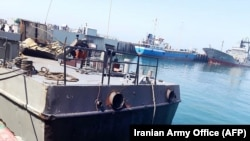 A handout photo made available by Iranian authorities shows the damaged Konarak warship in Jask, Iran. on May 11.