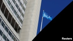 FILE PHOTO: The flag of the International Atomic Energy Agency (IAEA) flies in front of its headquarters during the General Conference in Vienna, Austria September 18, 2017. REUTERS/Leonhard Foeger/File Photo