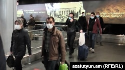 Armenian citizens wearing face masks to protect against the coronavirus returning from Iran last week.
