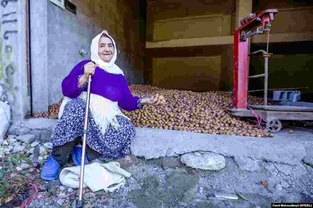 "Tofa Rizalizadeh is 70. She has five children and 11 grandchildren: ""My husband gathered medlars [fruit] from different gardens when he was alive. Now, my grandchildren are gathering them, and I sell them for 200,000 [rials] per kilo [about $6]."""