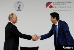 Путин и Абэ в Токио. 16 декабря