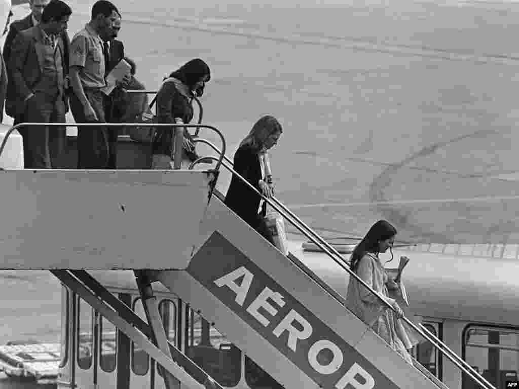 Former hostages, released by their captors, arrive at France's Orly airport on November 20, 1979.