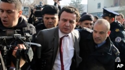 Top opposition lawmaker Albin Kurti (center) being arrested by Kosovar police in November
