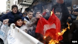 Russians burn a Turkish flag during a rally in front of the Turkish Embassy in Moscow on November 25.