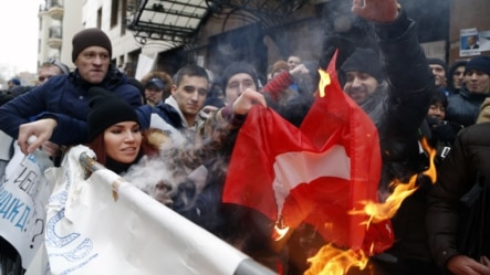 Russians burn a Turkish flag during a rally in front of Turkish Embassy in Moscow on November 25.