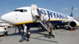 UKRAINE -- Passengers get off a Ryanair Boeing 737-8AS aircraft at the Boryspil International Airport near Kyiv, September 3, 2018