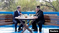 The two Korean leaders meet during their previous summit in April.