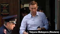 Russian opposition leader Aleksei Navalny leaves after a court hearing in Moscow last month.