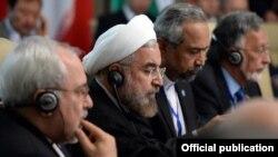 Президент Ирана Хасан Роухани во время заседания глав государств-членов ШОС в расширенном составе. 13 сентября 2013 года