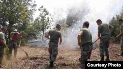 The army of the Republic of Macedonia extinguishes forest fires.Courtesy photo by ARM.