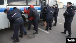 Russian Police detain alleged illegal migrants during a raid at a market in Moscow last month.