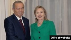 U.S. Secretary of State Hillary Clinton with Uzbek president Islam Karimov in Tashkent.