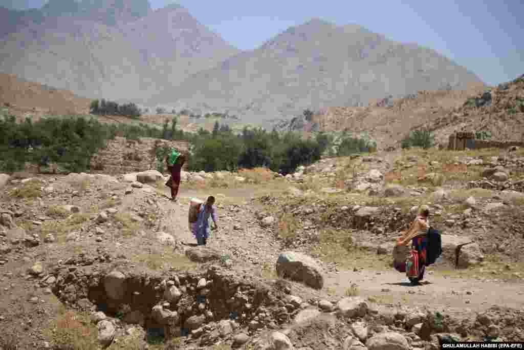 Civilians flee from the Alishang district of Laghman Province as Afghan security forces battled the Taliban on July 8.