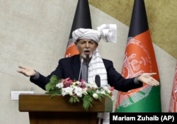 Afghan President Ashraf Ghani speaks during a parliament session in Kabul on October 21.