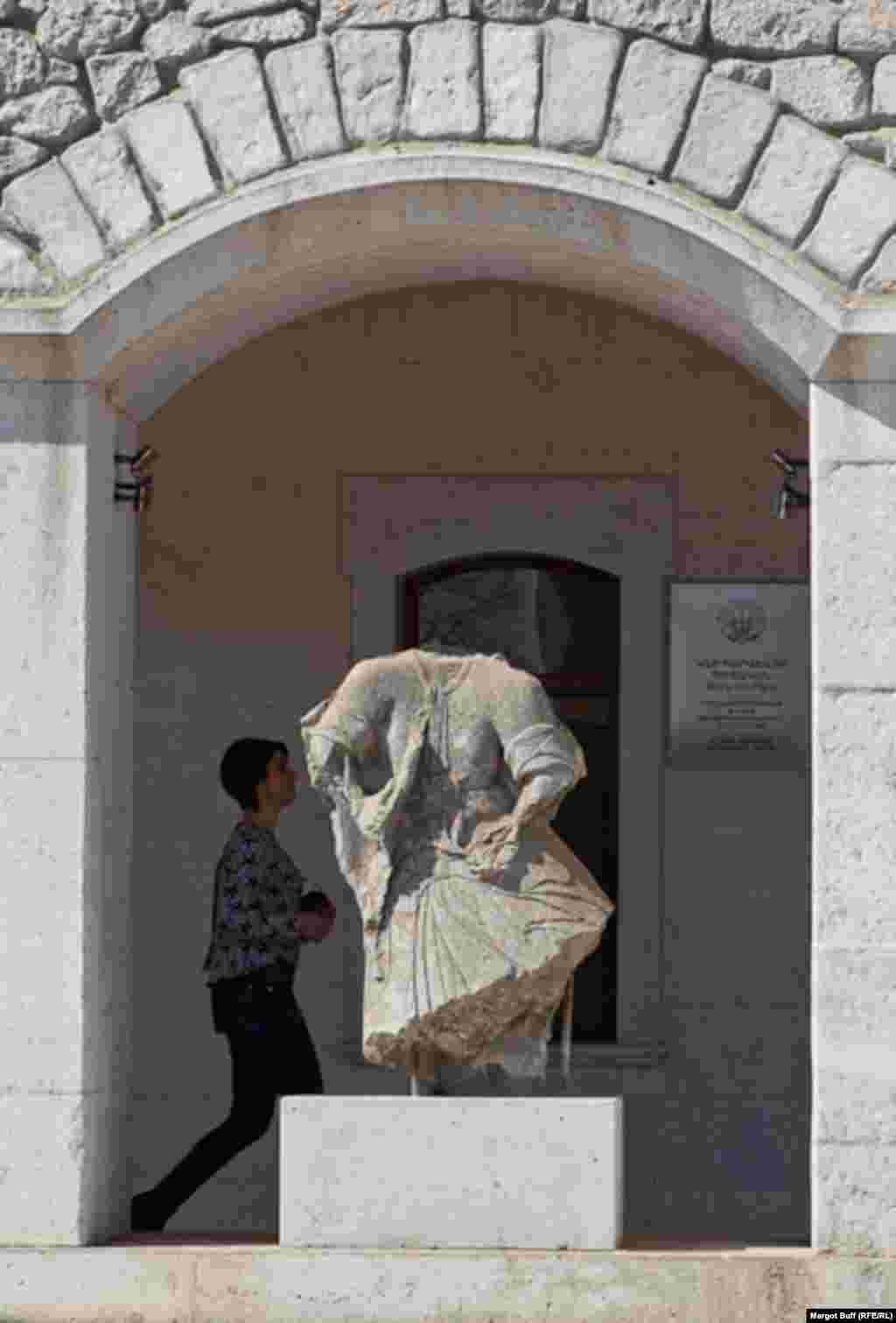 A damaged sculpture from the Ghazanchetsots Cathedral now stands in front of a museum.