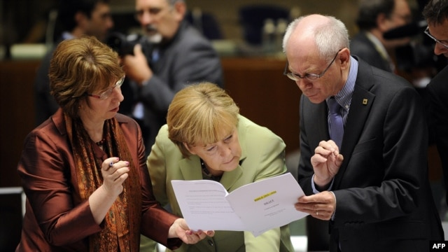 EU High Representative for Foreign Affairs and Security Policy Catherine Ashton, German Chancellor Angela Merkel, and European Council President Herman Van Rompuy (left to right) talk prior to the roundtable meeting in Brussels on June 28.