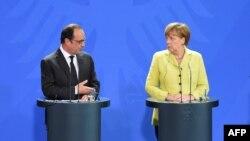 Angela Merkel dhe Francois Hollande gjatë një takimi të mëparshëm