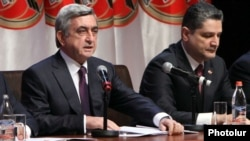 Armenia -- President Serzh Sarkisian (L) and Prime Minister Tigran Sarkisian at a congress of the ruling Republican Party, Yerevan, 10Mar2012.