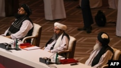 Members of the Taliban delegation attend the opening session of the peace talks with the Afghan government in Doha on September 12.