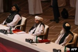 Members of the Taliban delegation attend the opening session of the peace talks in the Qatari capital, Doha, on September 12.