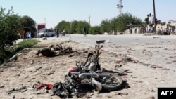 The wreckage of a motorcycle lies at the site of a bomb blast in Aqcha district in the northern province of Jawzjan on July 25.