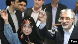 Zahra Rahnavard (left) votes with her husband, Mir Hossein Musavi, at a polling station in southern Tehran in the June 2009 presidential election.