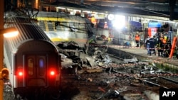Rescuers work through the night at the site of a deadly train crash near Paris on July 12.