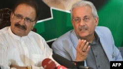 Senator Raza Rabbani (right) and Pakistan Peoples Party leader Ameen Fahim