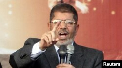 It was the first death reported in unrest since Egyptian President Muhammad Morsi, a former Muslim Brotherhood leader, issued a constitutional declaration granting himself powers to hand down decisions and laws that cannot be challenged in court.