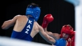 Kazakhstan - Ilia Popov RUS (red) in action against Talgat Shaiken KAZ in the Boxing Men's Light Welter (64kg) Gold Medal Bout at the Oceania Pavilion, Youth Olympic Park. The Youth Olympic Games, Buenos Aires, Argentina, Thursday 18th October 2018. Photo
