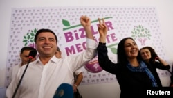 Turkey -- Co-chairs of the pro-Kurdish Peoples' Democratic Party (HDP), Selahattin Demirtas (L) and Figen Yuksekdag celebrate inside party's headquarters in Istanbul, June 7, 2015
