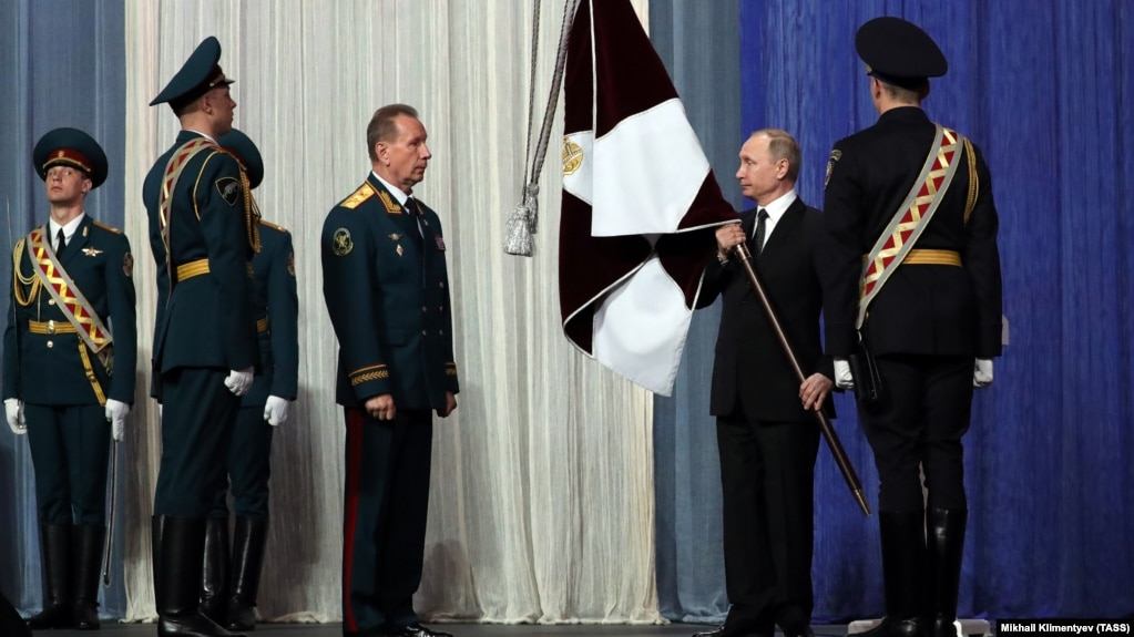 Vladimir Putin and Viktor Zolotov at a ceremony marking National Guard Day in Moscow in March