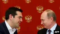 Greek Prime Minister Alexis Tsipras (left) speaks with Russian President Vladimir Putin during a signing ceremony at the Kremlin in Moscow on April 8.