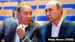Александр Масляков и Владимир Путин