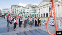 Members of the Belgian-Iranian community gather to protest against the mass execution of political prisoners in Iran in Brussels.