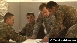 Armenia - A U.S. military officer conducts a training course for Armenian army sergeants, 27Feb2014.