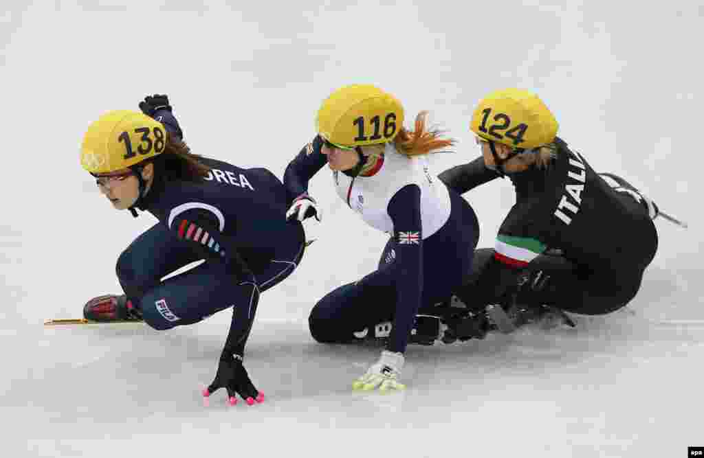 Elise Christie (center) of Great Britain collides with Arianna Fontana (right) of Italy and Park Seung-Hi of Korea in the women's 500 meters short track final. Fontana won gold.