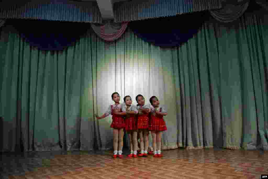 North Korean girls dance during a performance at a nursery school in the North Korean border town of Siniuju, across from China's northeastern city of Dandong. (AFP/Wang Zhao)