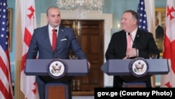 Georgian Prime Minister Mamuka Bakhtadze (left) and U.S. Secretary of State Mike Pompeo speak to the media on June 11.
