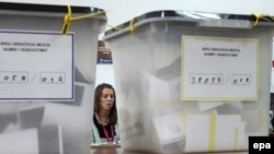 An electoral staff member waits for voters at a polling station in the ethnically divided city of Mitrovica on November 17.