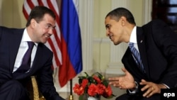 Presidents Dmitry Medvedev (left) and Barack Obama at their initial meeting in London on April 1